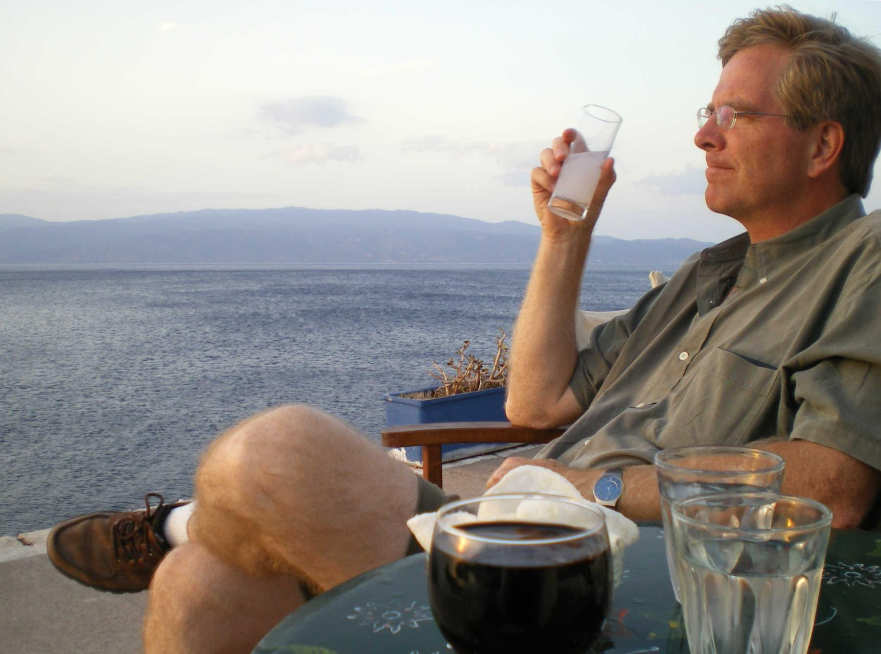 Rick Drinking Ouzo, Hydra, Greece