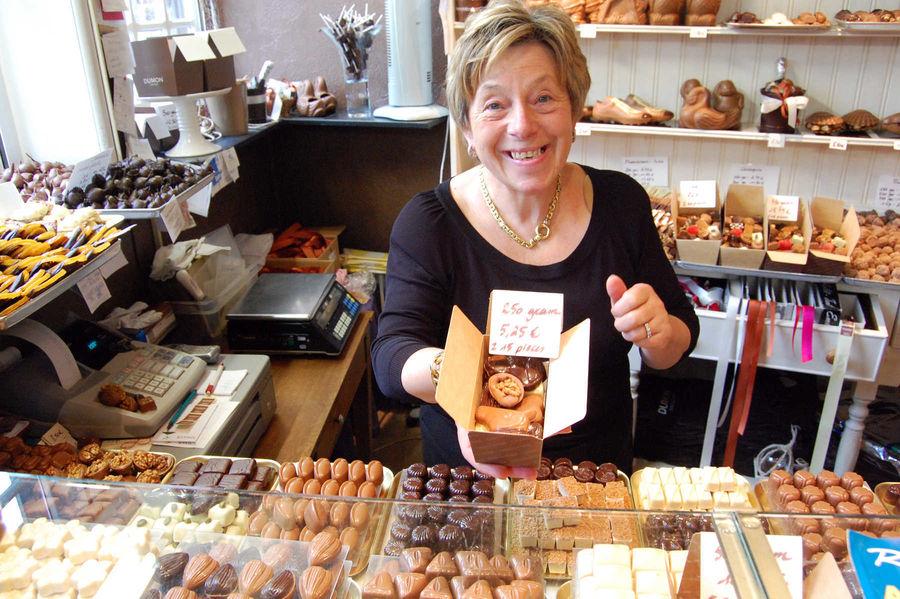Mme Dumon in her chocolate shop, Bruges, Belgium