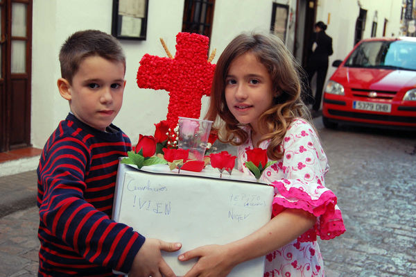 Preparing for Festival of the Crosses procession, Córdoba, Spain