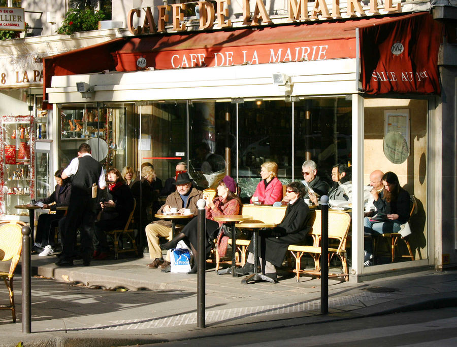 Sitting outside the Café de la Mairie in winter, Paris, France
