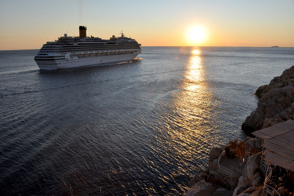 Cruise ship leaving Dubrovnik, Croatia at sunset