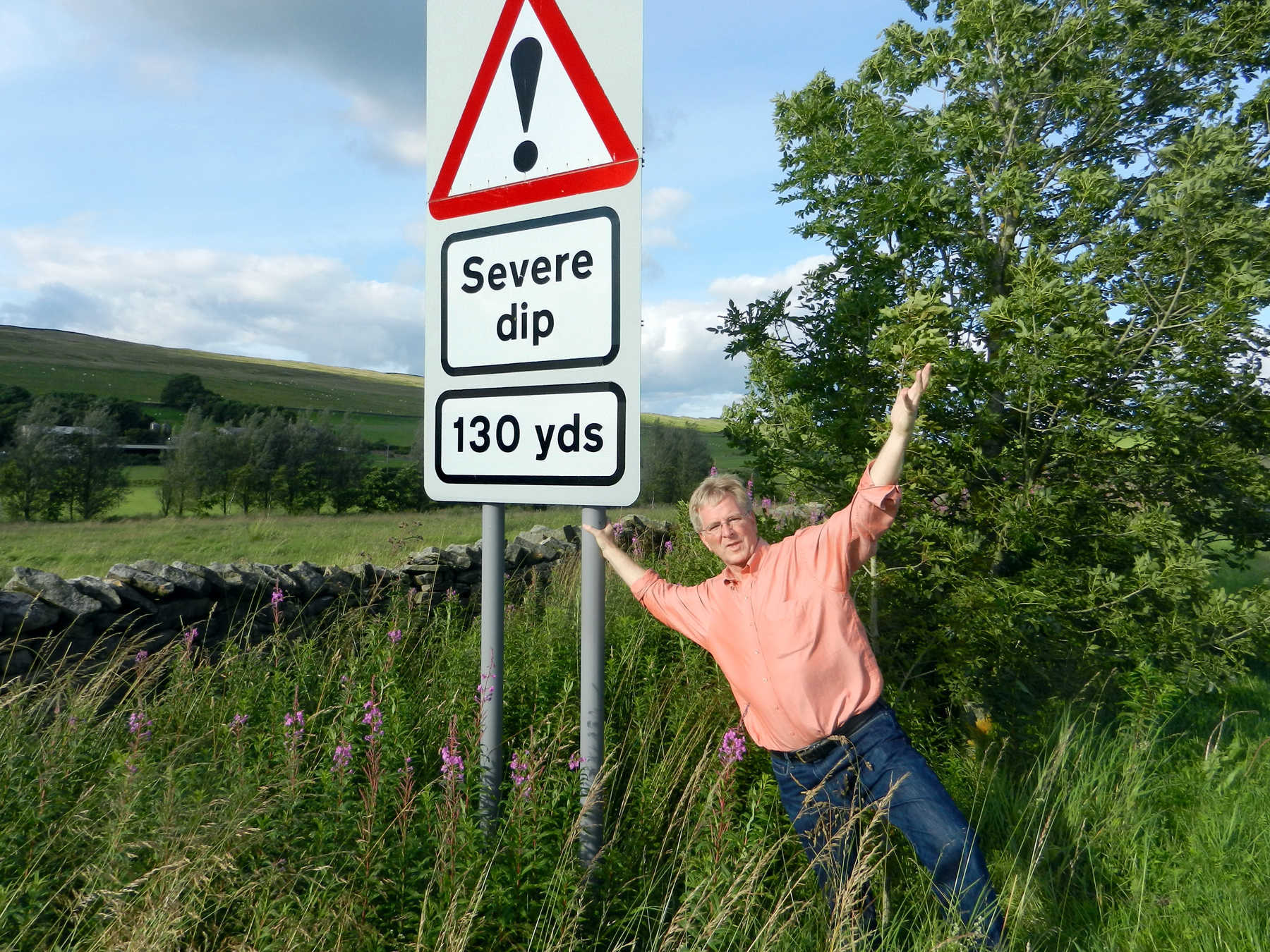 Rick Steves and Severe Dip Sign, Lake District, England