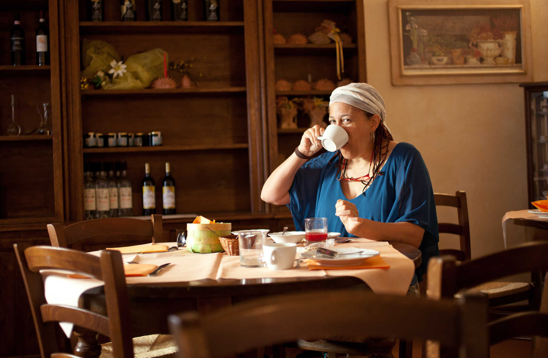 Woman Eating Italian Breakfast