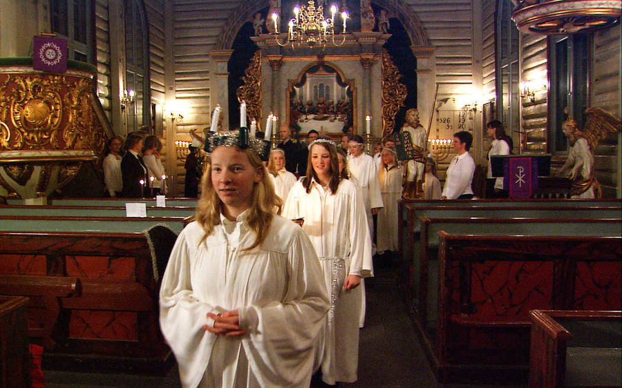 choir girls in church santa lucia christmas norway