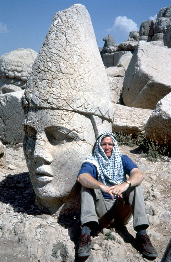 Rick among the ruined statues of Mt. Nemrut, Turkey
