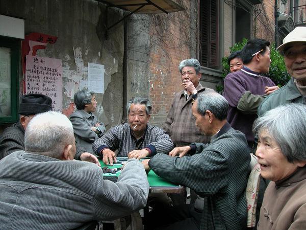 Elderly locals playing mahjong, Shanghai, China