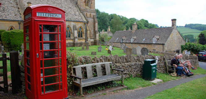 Phone box and churchyard, Snowshill, England