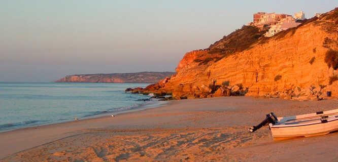 Sunrise on the beach in Salema, Portugal