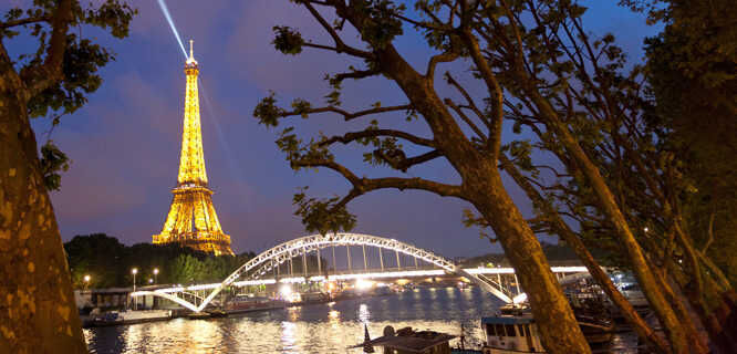 Eiffel Tower and Passerelle Debilly bridge at night, Paris, France