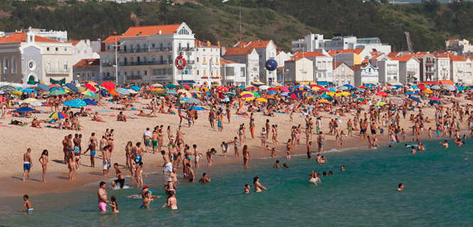 Beachgoers in Nazaré, Portugal