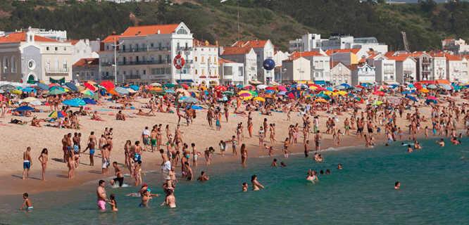 Beachgoers in Nazaré, Portugal