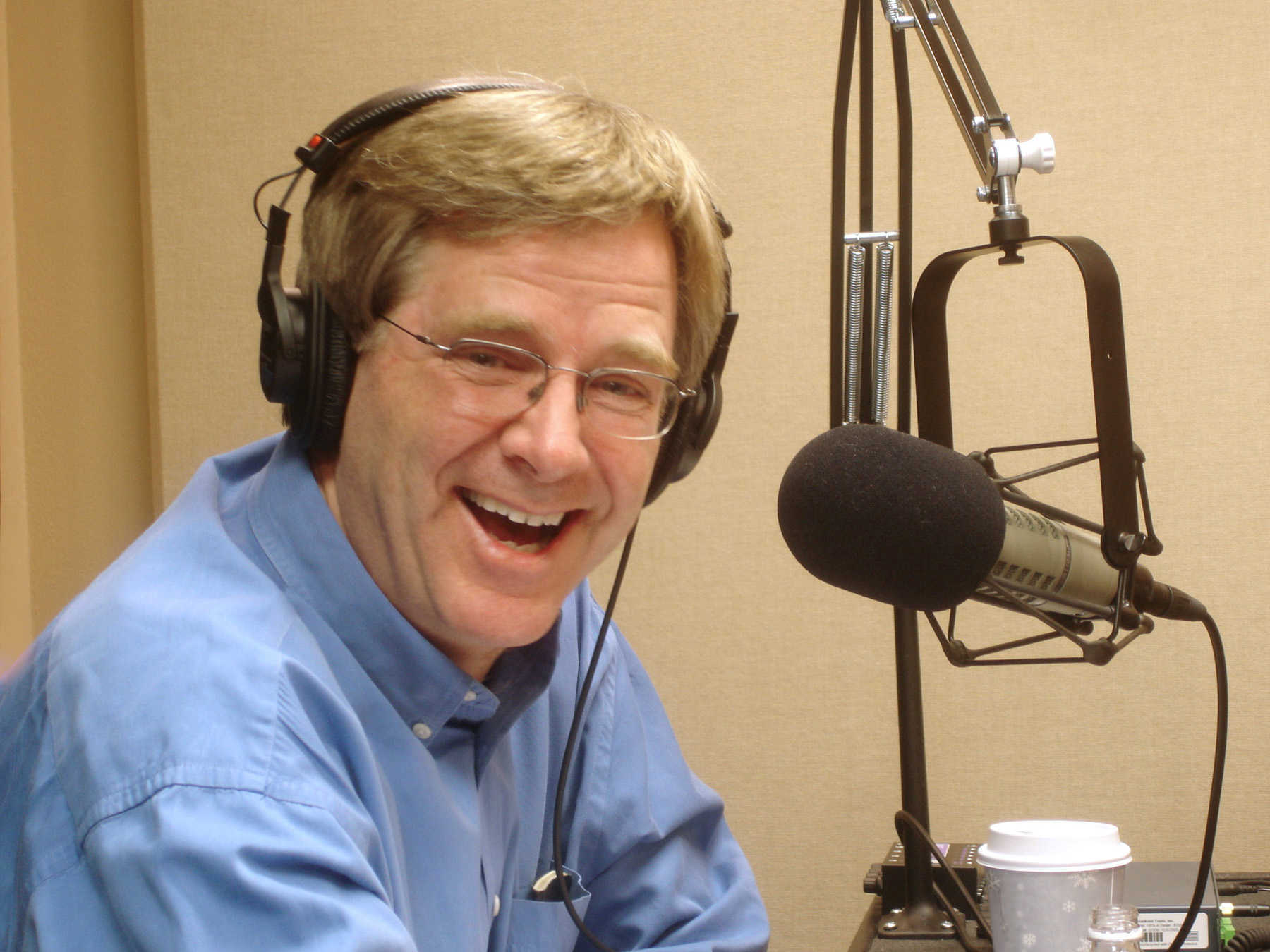At the mic for his radio show, <em>Travel with Rick Steves</em>