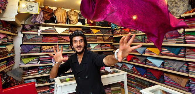 Grand Bazaar scarf merchant, Istanbul, Turkey