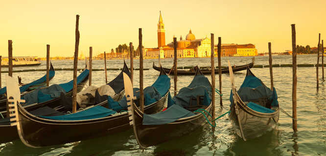 Gondolas and Church of San Giorgio Maggiore at sunset, Venice, Italy