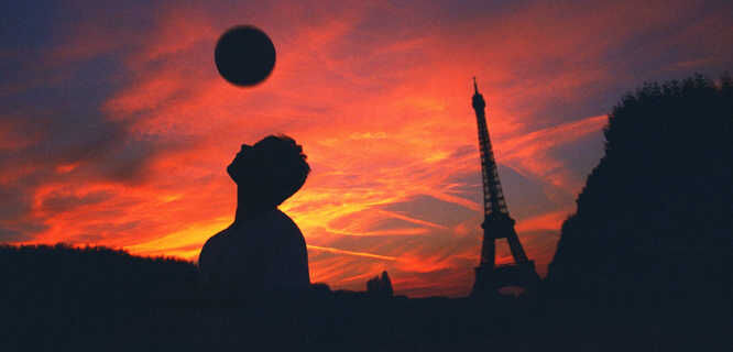 Soccer player on Champ de Mars at sunset, Paris, France