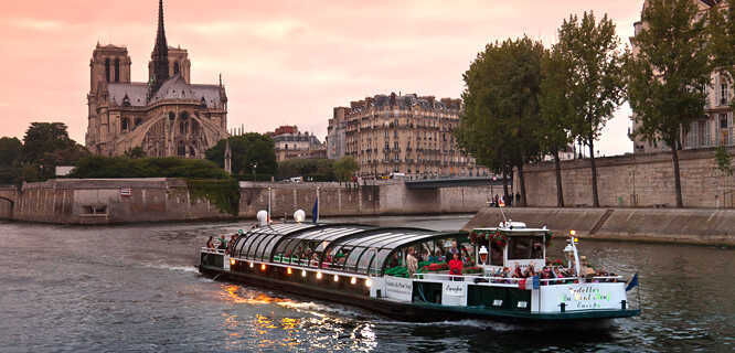 Seine River tour boat and Notre-Dame Cathedral, Paris, France