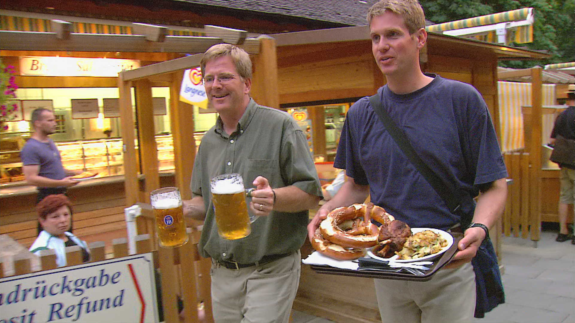 Rick Steves with beer steins and giant pretzels in Bavaria