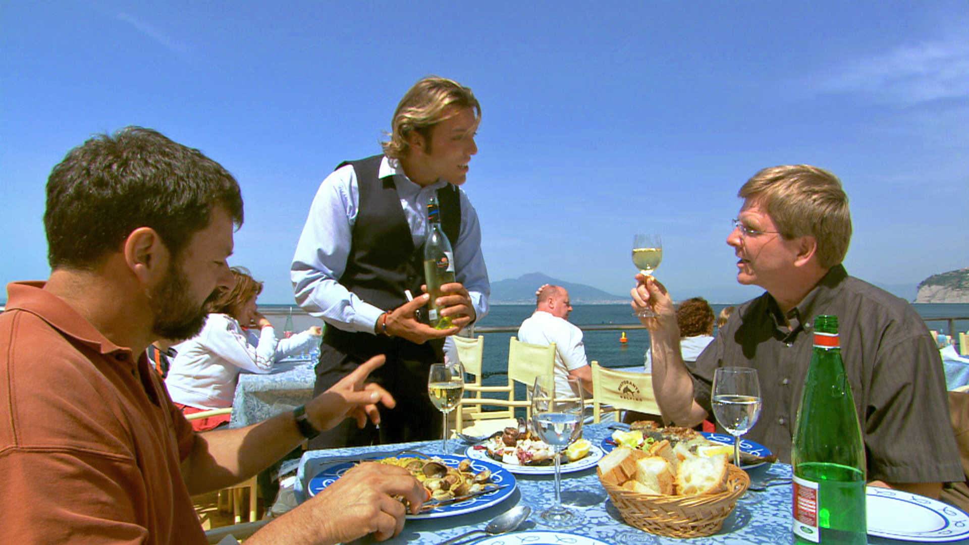Rick Steves and Simon take lunch on the Amalfi Coast