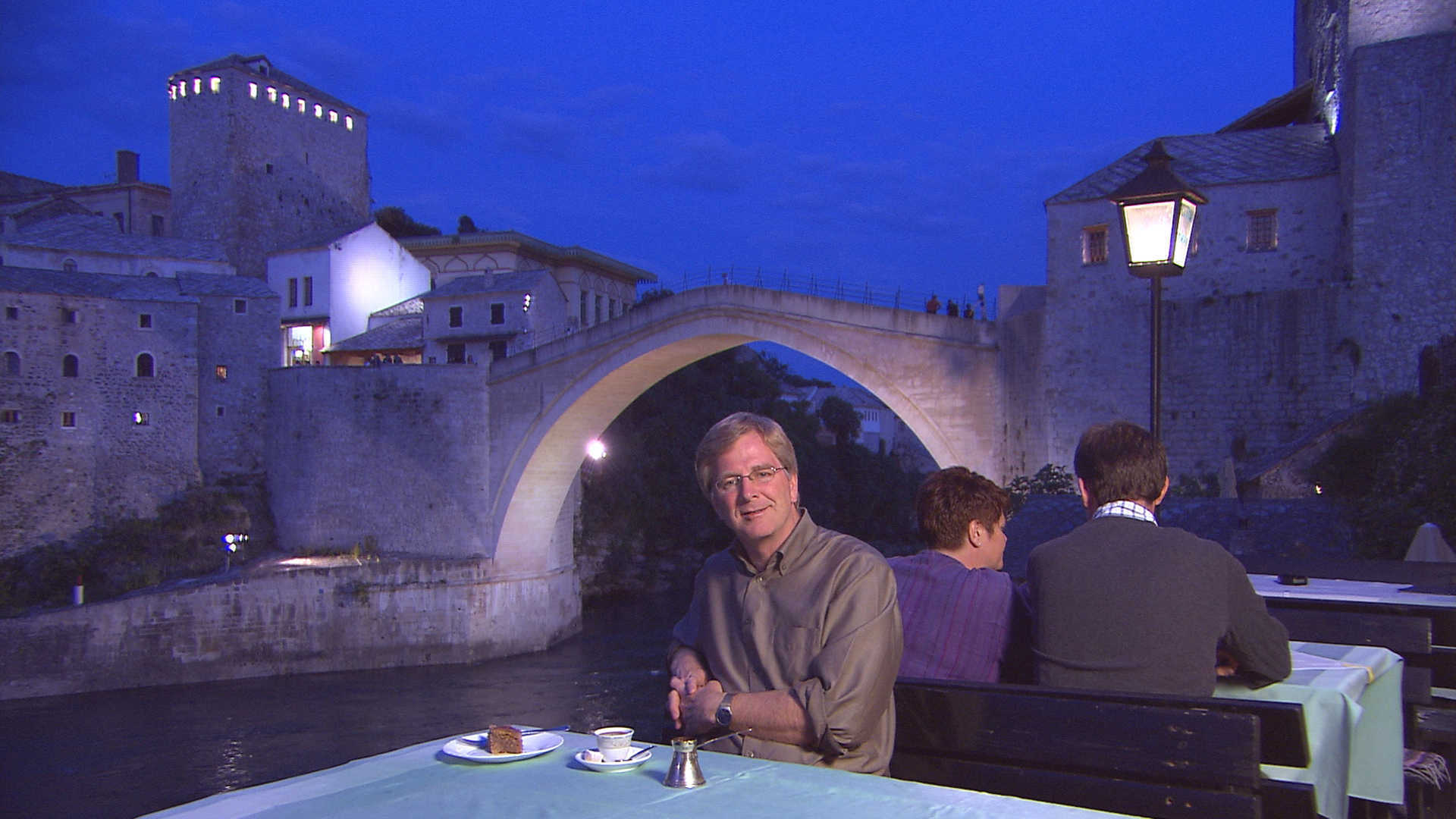 Rick Steves under the Mostar Bridge at night