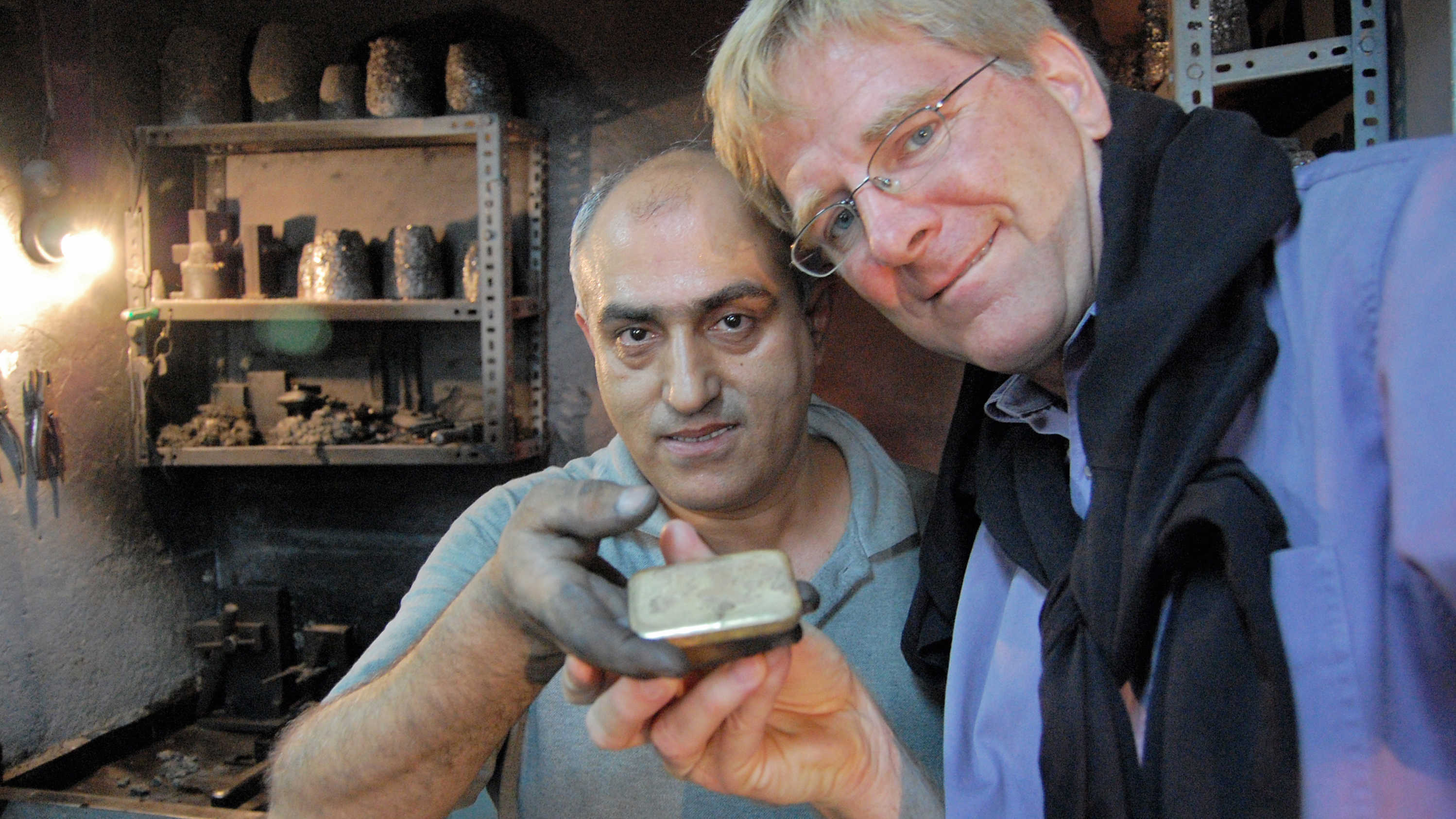 A goldsmith poses with Rick Steves