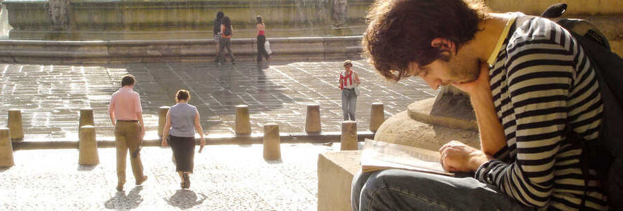 Reading on the steps of St. Sulpice Church, Paris, France