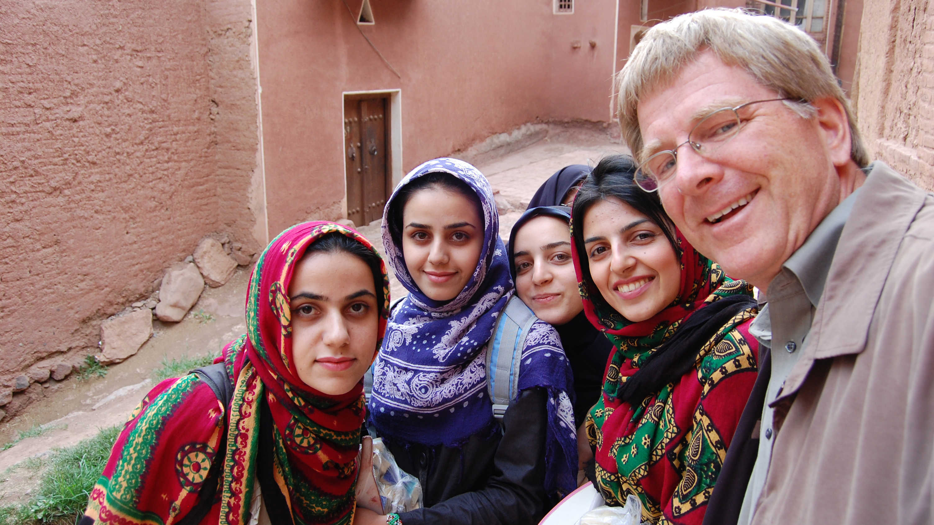 Rick poses with local girls in Iran