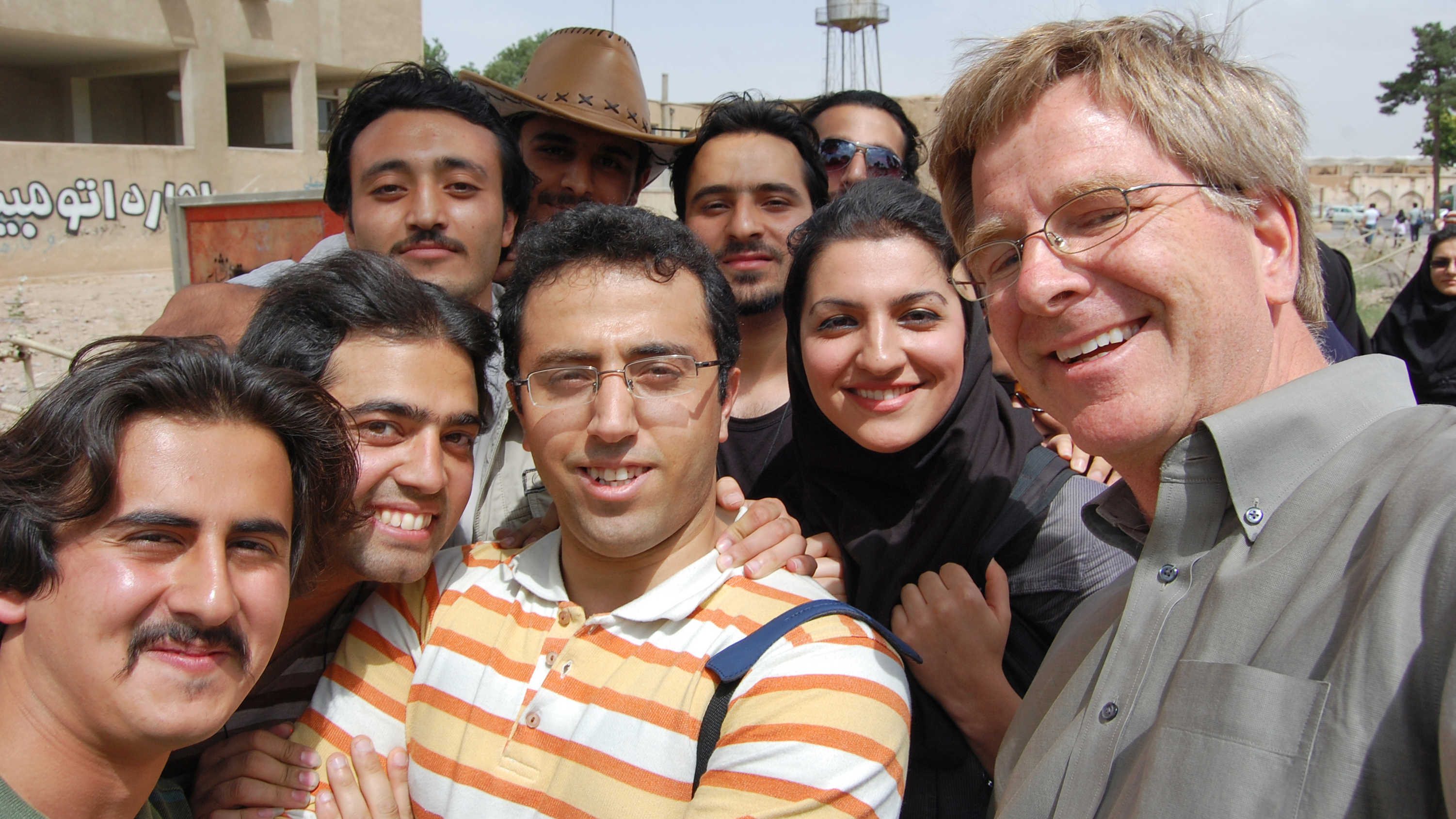 Rick Steves poses with students