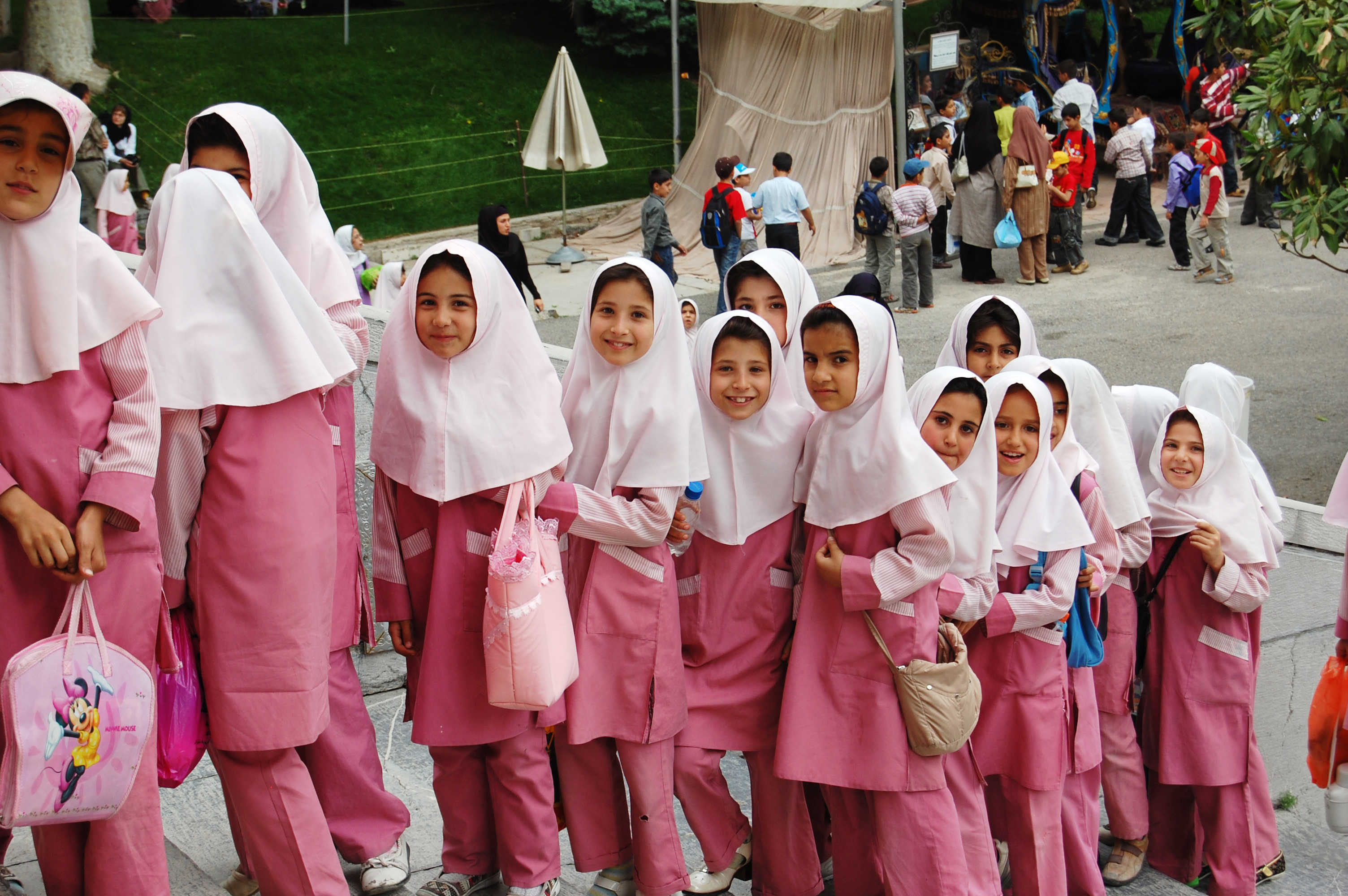 Iranian school girls in pink garments.