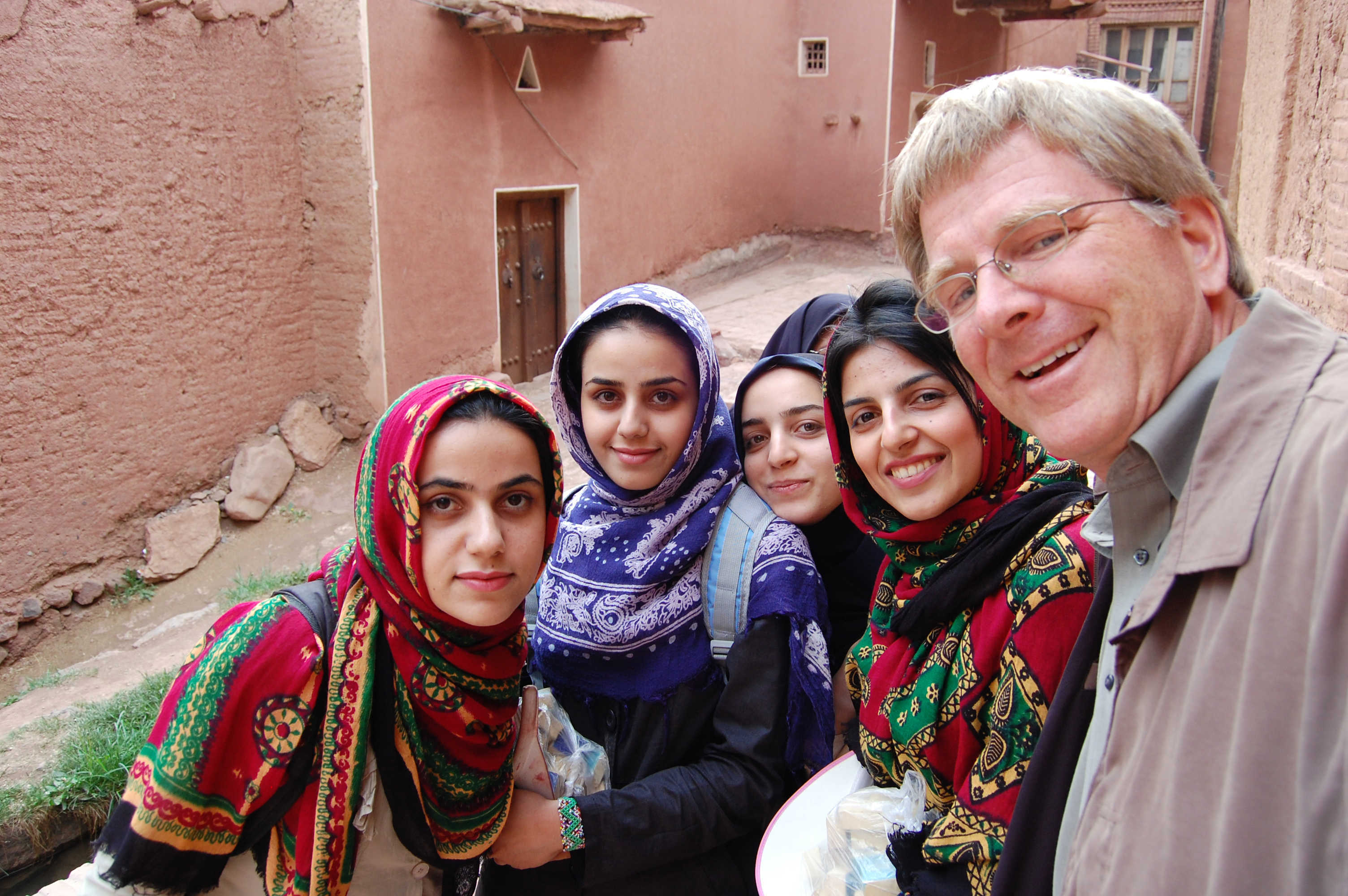 Village girls pose with Rick Steves in Iran