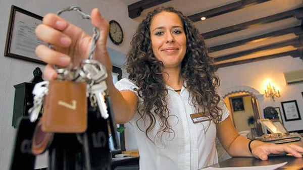 A hotelier holding room keys