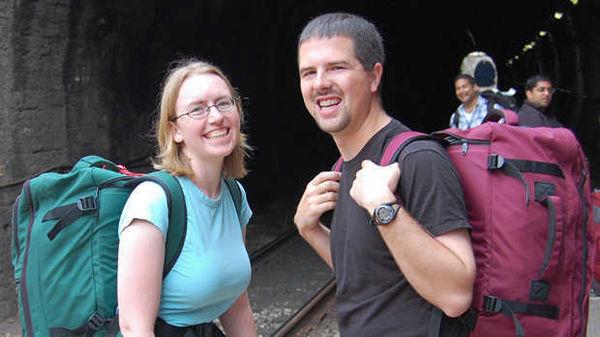 A couple wearing backpacks