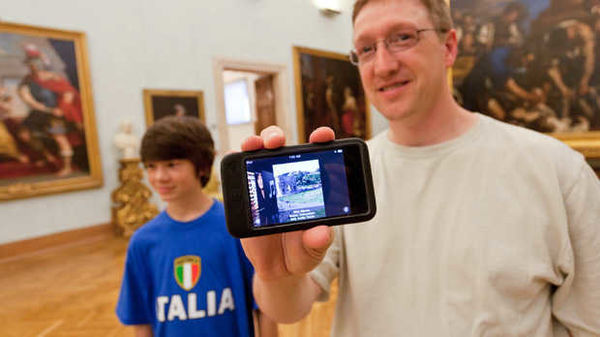 Holding a smartphone in a museum