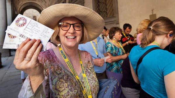 Holding tickets to the Uffizi