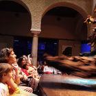A flamenco dancer twirls her dress