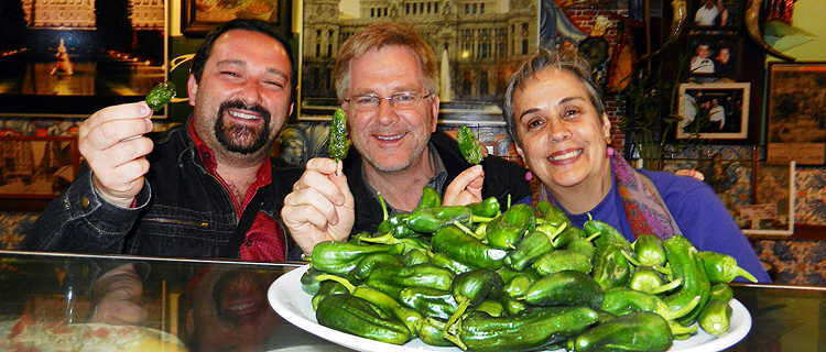 Picking from a tapas pepper platter in Madrid, Spain