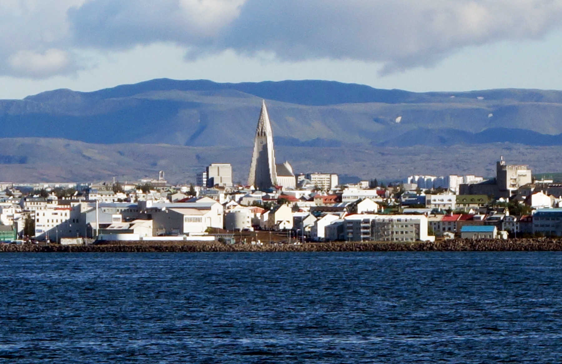 The skyline of Reykjavik, Iceland features Hallgrimskirkja, a towering Lutheran church