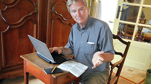 Rick Steves sits with his laptop