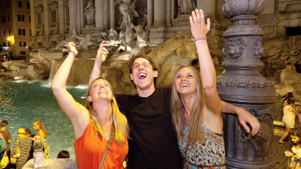 Coin tossing at Trevi Fountain, Rome, Italy