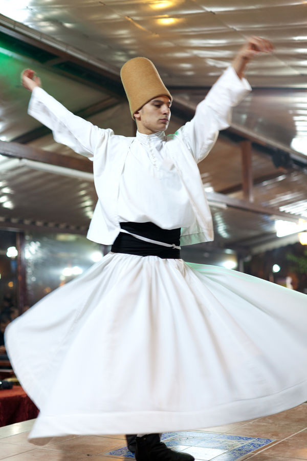 Whirling dervish (semazen), Sultanahmet neighborhood, Istanbul, Turkey