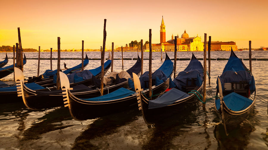 Gondola stand and Church of San Giorgio Maggiore at sunset, Venice, Italy