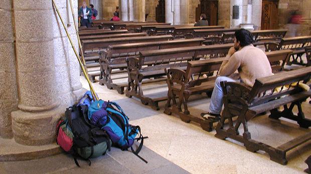 Pilgrim inside cathedral of Santiago de Compostela, Spain