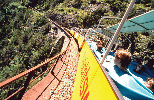 Open-air train on the Landwasser Viaduct, Bernina Express route, Graubünden, Switzerland