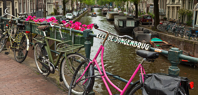 Bikes on canal bridge, Amsterdam, Netherlands