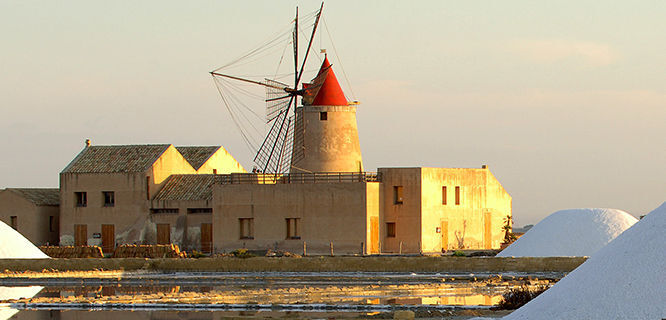 Windmill on Marsala salt flats, Sicily, Italy
