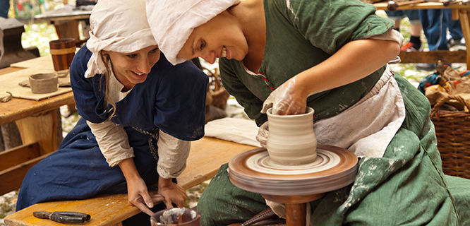 Artisans at work in pottery workshop, Kraków, Poland