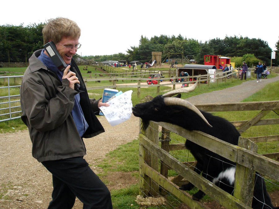Rick with map-eating goat, Cotswold Farm Park, Cotswolds, England
