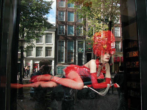 Mannekin in the Red Light District, Amsterdam, Netherlands