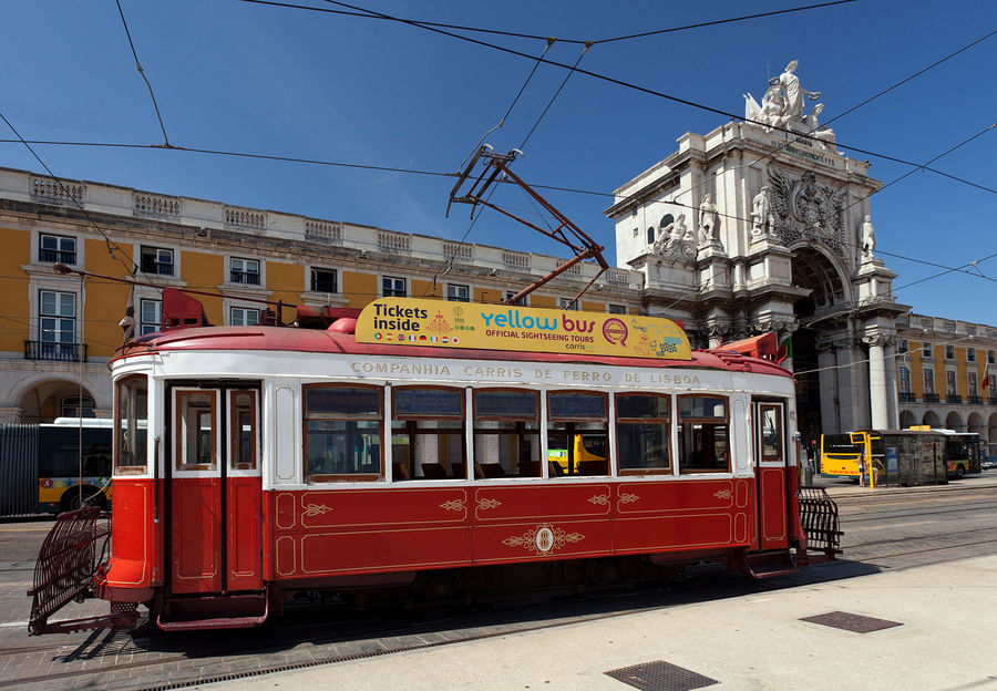 Tourist trolley on Praça do Comércio, Lisbon, Portugal