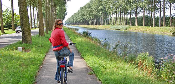 Canalside bike ride, Bruges, Belgium