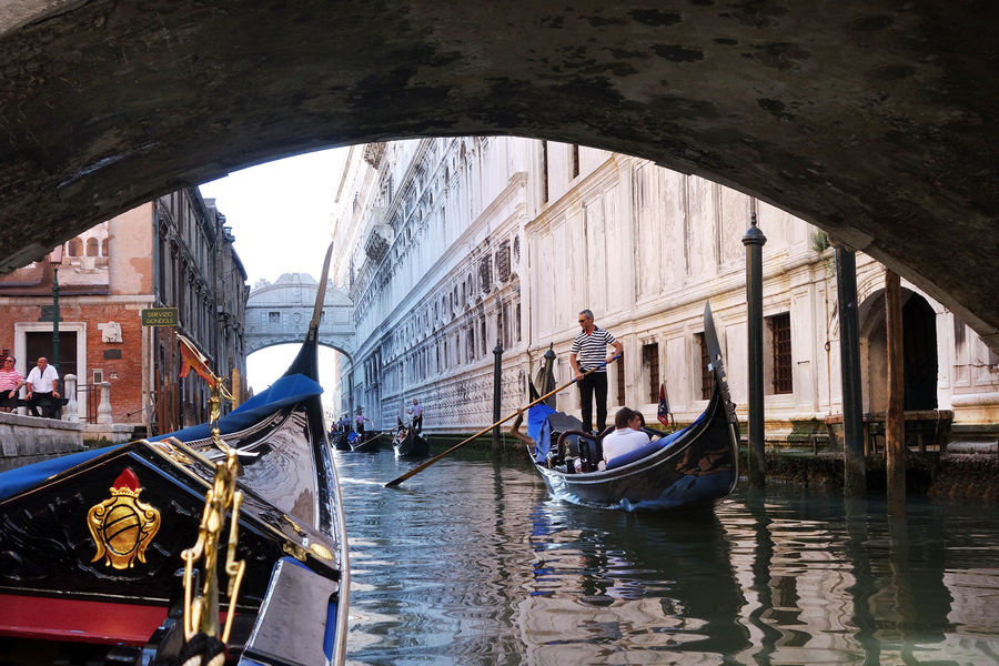 Riding a gondola toward the Bridge of Sighs, Venice, Italy